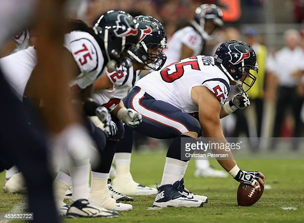 Center Chris Myers of the Houston Texans prepares to snap the football during the preseason NFL game against the Arizona Cardinals at the University...