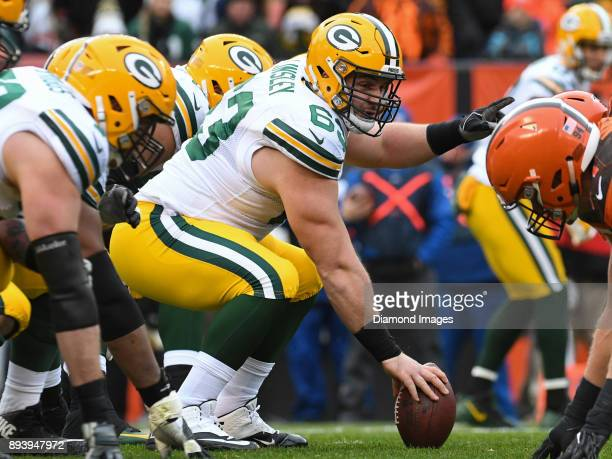 Center Corey Linsley of the Green Bay Packers points toward the defense as he awaits the snap call in the second quarter of a game on December 10...