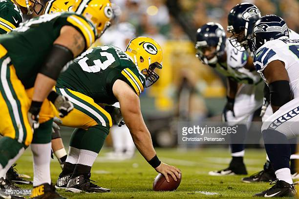 Center Corey Linsley of the Green Bay Packers prepares to snap the football against the Seattle Seahawks during the NFL game at Lambeau Field on...