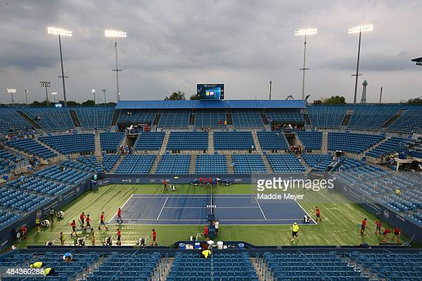 Center Court is dried before the start of a match during Day 3 of the Western & Southern Open at the Linder Family Tennis Center on August 17, 2015...