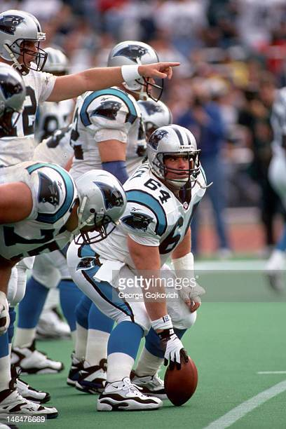 Center Curtis Whitley of the Carolina Panthers looks up from the line of scrimmage as quarterback Kerry Collins points during a game against the...