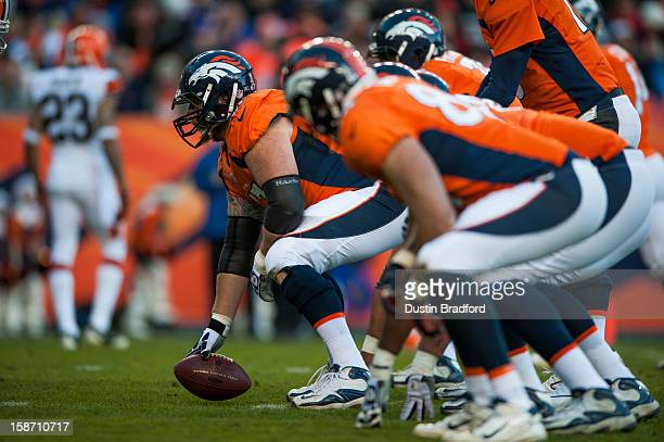 Center Dan Koppen of the Denver Broncos lines up against the Cleveland Browns during a game at Sports Authority Field at Mile High on December 23...