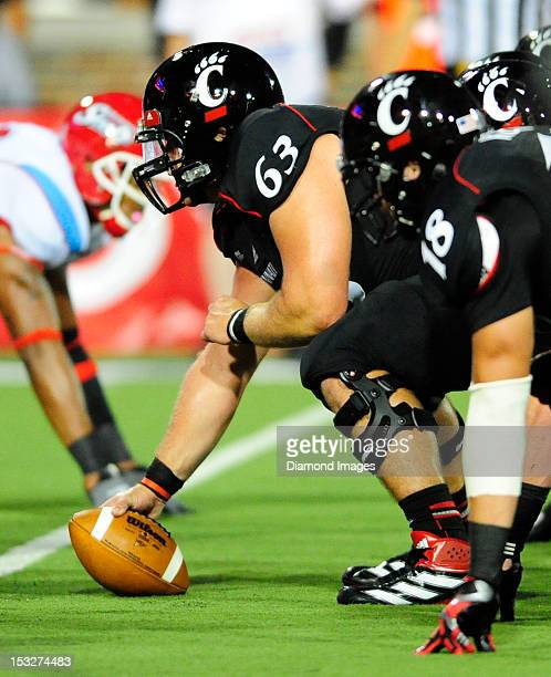 Center Dan Sprague of the Cincinnati Bearcats waits to snap the football during a game with the Delaware State Hornets at Nippert Stadium in...