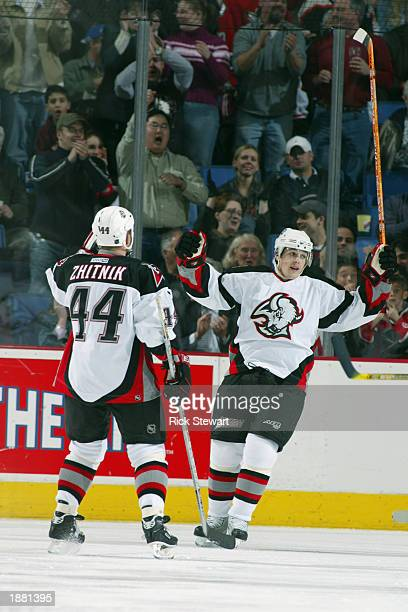 Center Daniel Briere of the Buffalo Sabres celebrates with teammate defenseman Alexei Zhitnik after Briere scored against the Philadelphia Flyers at...