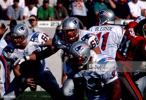 Center Dave Wohlabaugh of the New England Patriots with his teammate Guard Max Lane protect the pocket for Quarterback Drew Bledsoe#11 in a NFL game...