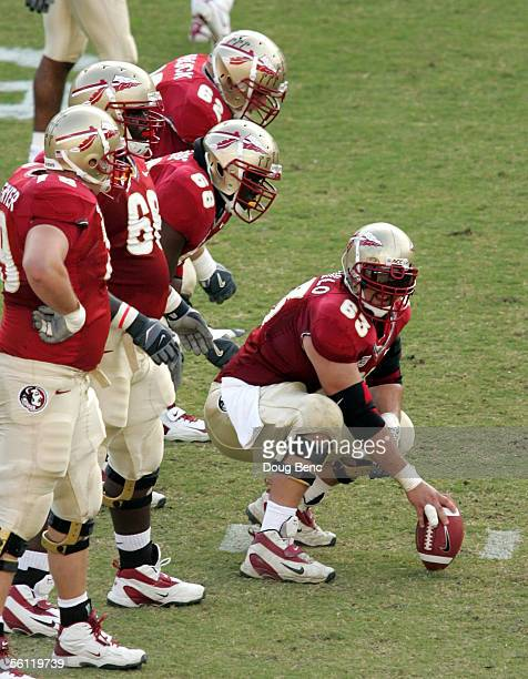 Center David Castillo of the Florida State Seminoles prepares to snap the ball against the North Carolina State Wolfpack at Doak Campbell Stadium on...