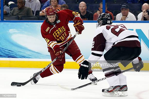 Center Derek Graham of the Ferris State Bulldogs shoots against the Union Dutchman during the NCAA Division 1 Men's Hockey Championship Semifinal...
