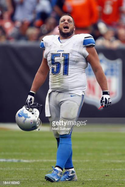 Center Dominic Raiola of the Detroit Lions celebrates a touchdown as he walks off the field against the Cleveland Browns at FirstEnergy Stadium on...