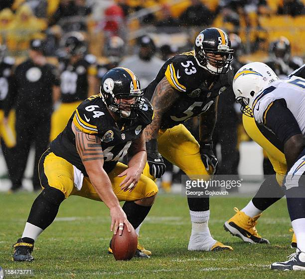 Center Doug Legursky and guard Maurkice Pouncey of the Pittsburgh Steelers look on from the line of scrimmage as rain falls during a game against the...