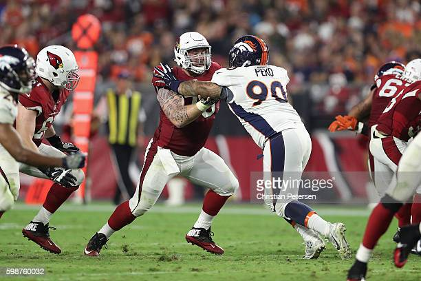 Center Evan Boehm of the Arizona Cardinals in action during the preseaon NFL game against the Denver Broncos at the University of Phoenix Stadium on...