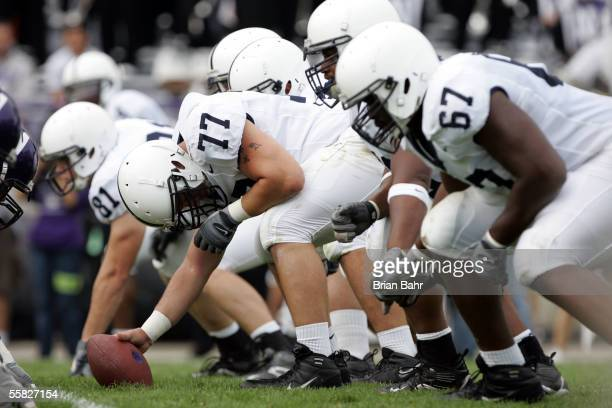Center E.Z. Smith of the Penn State Nittany Lions gets set to snap the ball against the Northwestern Wildcats September 24, 2005 at Ryan Field in...