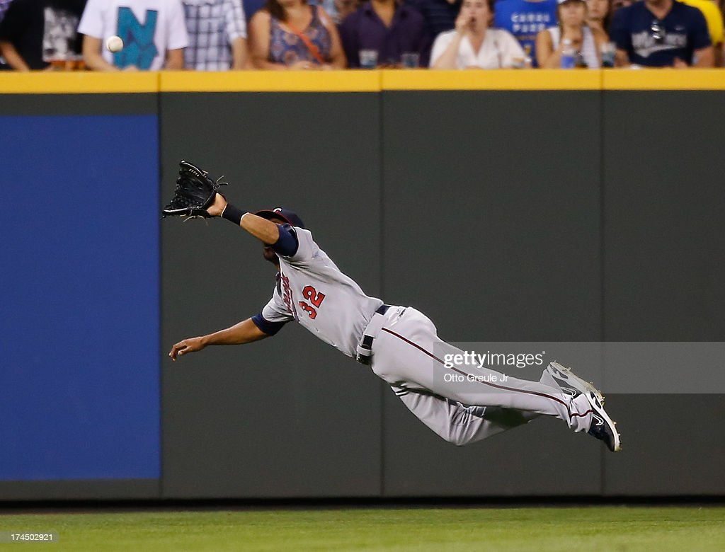 Center fielder Aaron Hicks #32 of the Minnesota Twins makes a diving catch on a fly ball by Henry Blanco (not pictured) of the Seattle Mariners in the seventh inning at Safeco Field on July 26, 2013 in Seattle, Washington.