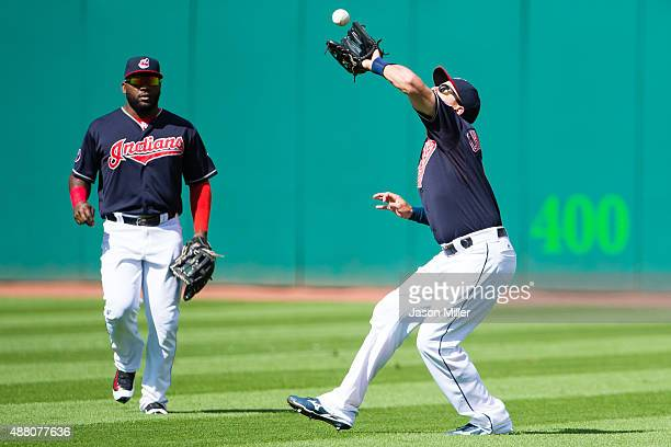 Center fielder Abraham Almonte watch as right fielder Lonnie Chisenhall of the Cleveland Indians catches a fly ball hit by Miguel Cabrera of the...