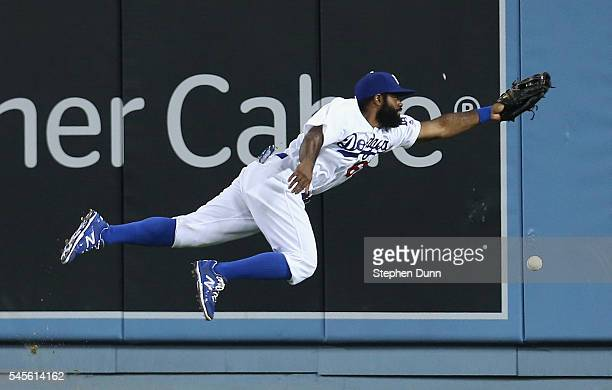 Center fielder Andrew Toles of the Los Angeles Dodgers dives but can't reach a double hit by Yangervis Sarte of the San Diego Padres in the sixth...
