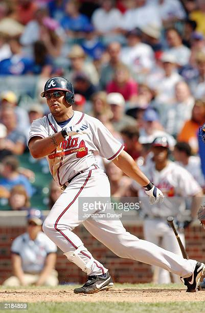 Center fielder Andruw Jones of the Atlanta Braves heads to first base during the game against the Chicago Cubs at Wrigley Field on July 10 2003 in...