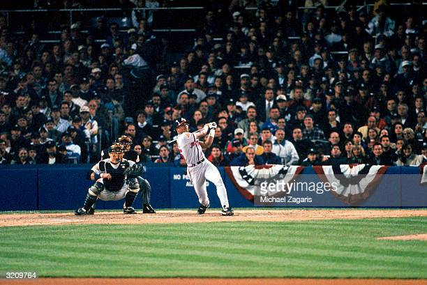 Center fielder Andruw Jones of the Atlanta Braves hits his first career home run in the second inning of Game 1 of the 1996 World Series against the...