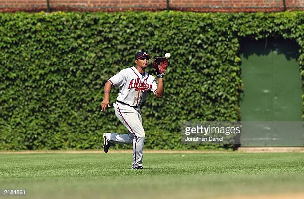 Center fielder Andruw Jones of the Atlanta Braves makes the catch during the game against the Chicago Cubs at Wrigley Field on July 10 2003 in...