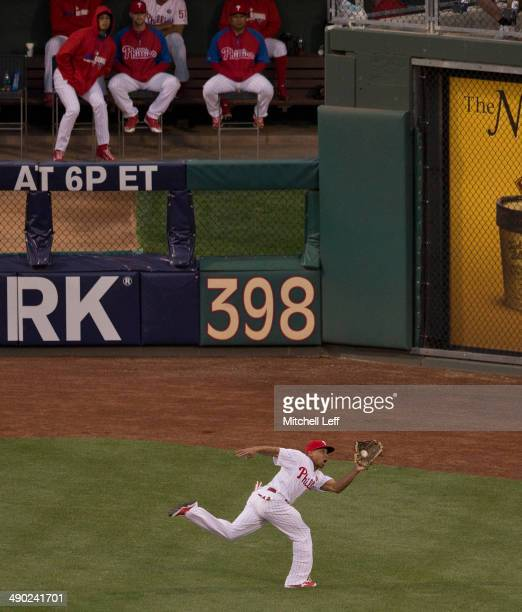 Center fielder Ben Revere of the Philadelphia Phillies makes a diving catch in the top of the fourth inning against the Los Angeles Angels of Anaheim...