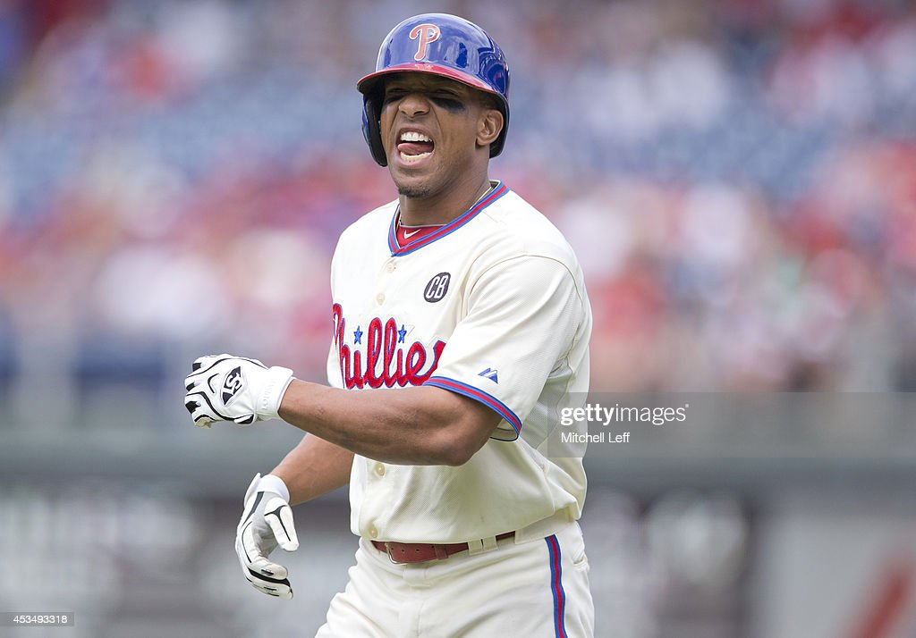 Center fielder Ben Revere #2 of the Philadelphia Phillies winces after beating out an infield single in the bottom of the third inning against the New York Mets on August 11, 2014 at Citizens Bank Park in Philadelphia, Pennsylvania.