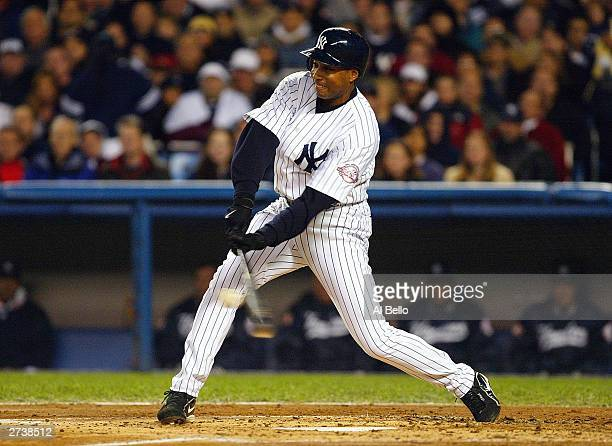 Center fielder Bernie Williams of the New York Yankees connects on a sacrifice fly to give the Yankees a 1-0 first inning lead over the Minnesota...