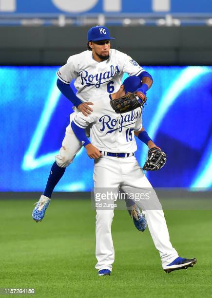 Center fielder Billy Hamilton jumps on right fielder Whit Merrifield of the Kansas City Royals as they celebrate a 4-1 win over the Minnesota Twins...