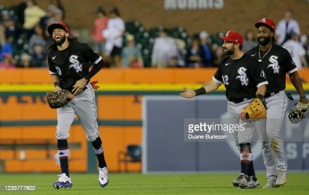 Center fielder Billy Hamilton of the Chicago White Sox laughs with Adam Eaton and Brian Goodwin after a 8-2 win over the Detroit Tigers at Comerica...