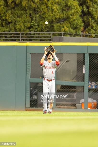 Center fielder Billy Hamilton of the Cincinnati Reds catches a fly ball hit by Michael Brantley of the Cleveland Indians to end the seventh inning at...