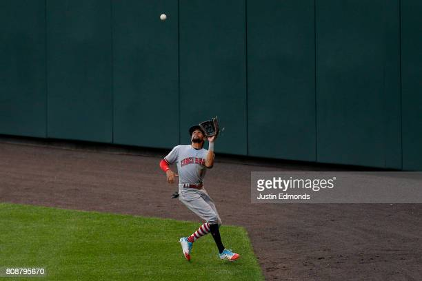 Center fielder Billy Hamilton of the Cincinnati Reds makes a catch on the warning track for the first out of the fourth inning during the game...