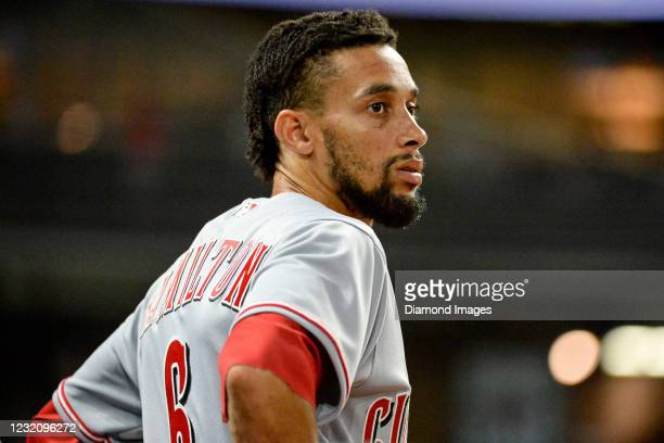 Center fielder Billy Hamilton of the Cincinnati Reds watches from the dugout in the ninth inning of a game against the Cleveland Indians at...