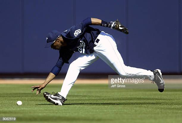 Center Fielder Brian Hunter of the San Diego Padres fields a base hit during a spring training game against the Seattle Mariners on March 7 2004 at...
