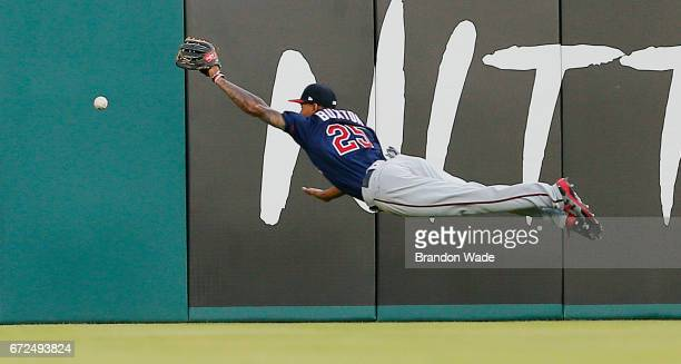 Center fielder Byron Buxton of the Minnesota Twins is unable to catch a ball off the bat of Mike Napoli of the Texas Rangers during the second inning...