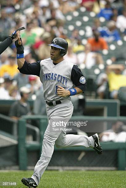 Center fielder Carlos Beltran of the Kansas City Royals crosses home plate in the fourth inning on a sacrifice fly ball against the Detroit Tigers...