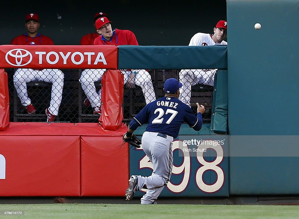 Center fielder Carlos Gomez #27 of the Milwaukee Brewers chases down a ball hit for a double by pitcher Sean O'Sullivan #47 of the Philadelphia Phillies during the second inning of a MLB game at Citizens Bank Park on June 29, 2015 in Philadelphia, Pennsylvania.