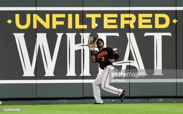 Center fielder Cedric Mullins of the Baltimore Orioles catches a ball hit by Ryan O'Hearn of the Kansas City Royals in the fifth inning at Kauffman...
