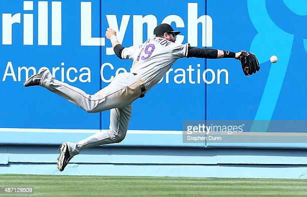 Center fielder Charlie Blackmon of the Colorado Rockies dives but can't catch a double hit by Matt Kemp of the Los Angeles Dodgers in the eighth...