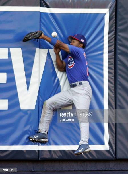 Center fielder Corey Patterson of the Chicago Cubs can't make a catch resulting in a two-run double for Olmedo Saenz of the Los Angeles Dodgers...