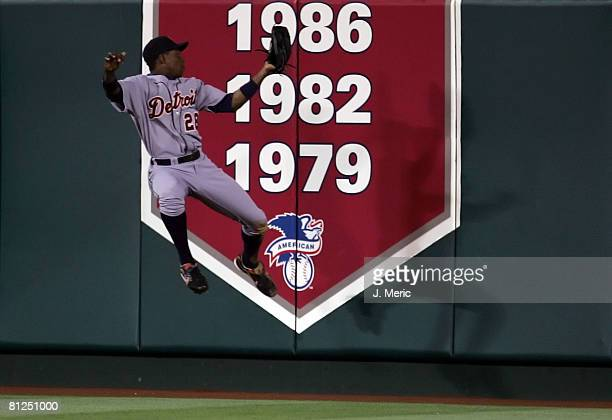 Center fielder Curtis Granderson of the Detroit Tigers makes a catch at the wall on a fly ball hit by Casey Kotchman of the Los Angeles Angels of...