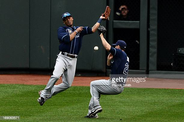 Center fielder Desmond Jennings of the Tampa Bay Rays and teammate Matt Joyce almost collide as they miss a hit to the outfield against the Baltimore...