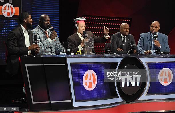 Center fielder Dexter Fowler of the St Louis Cardinals joins TNT's Inside the NBA team NBA analyst Shaquille O'Neal host Ernie Johnson Jr wearing an...