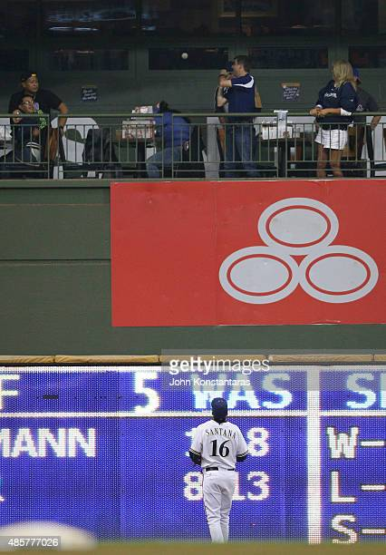 Center fielder Domingo Santana of the Milwaukee Brewers watches as a home run by Joey Votto of the Cincinnati Reds heads into the stands during the...