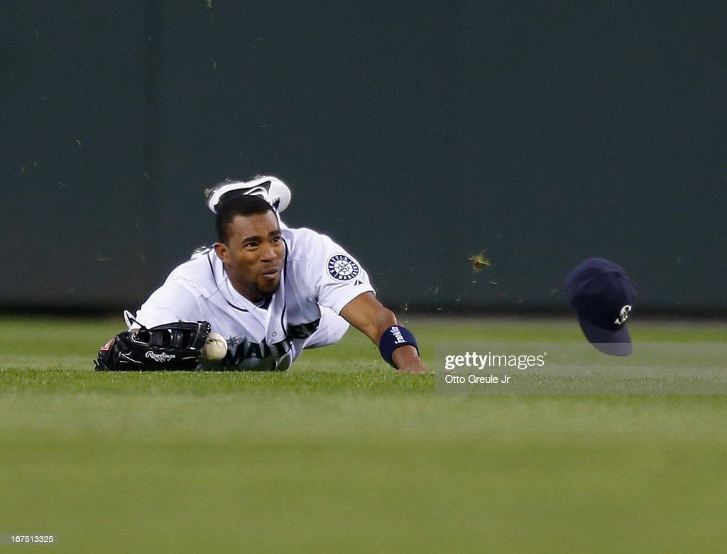 Center fielder Endy Chavez #9 of the Seattle Mariners just misses making a diving catch on a ball hit by Luis Jimenez of the Los Angeles Angels of Anaheim in the fourth inning at Safeco Field on April 25, 2013 in Seattle, Washington.