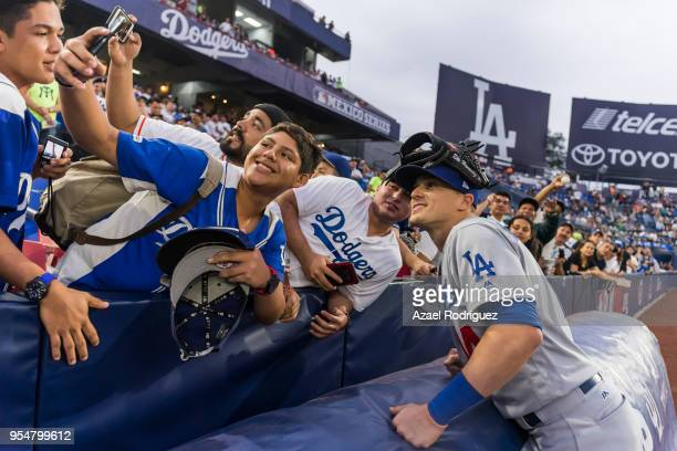 Center fielder Enrique Hernandez of Los Angeles Dodgers poses for a selfie with a fan prior the MLB game against the San Diego Padres at Estadio de...