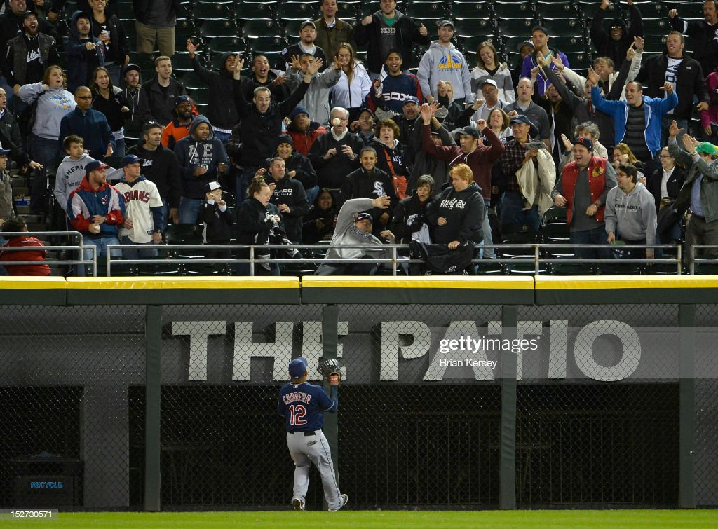 Center fielder Ezequiel Carrera #12 of the Cleveland Indians watches as a three-run home run hit by Adam Dunn #32 of the Chicago White Sox leaves the park at U.S. Cellular Field on September 24, 2012 in Chicago, Illinois. The White Sox defeated the Indians 5-4.