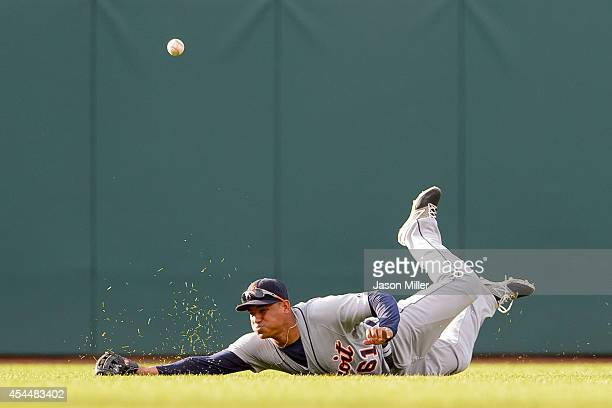 Center fielder Ezequiel Carrera of the Detroit Tigers misses on a diving catch hit by Zach Walters of the Cleveland Indians during the sixth inning a...