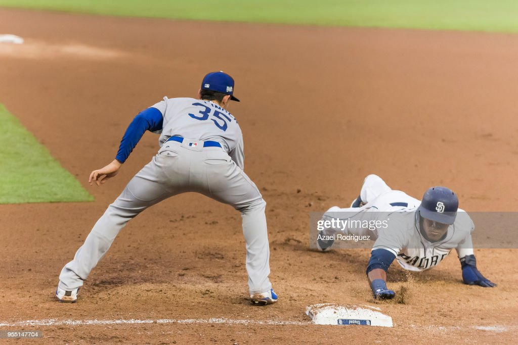 Center fielder Franchy Cordero #33 of San Diego Padres sunks into first base in the second inning during the MLB game againstthe Los Angeles Dodgers at Estadio de Beisbol Monterrey on May 5, 2018 in Monterrey, Mexico. Padres defeated the Dodgers 7-4.