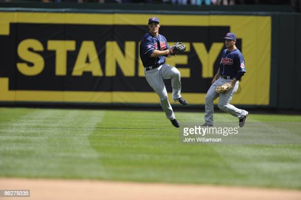 Center fielder Grady Sizemore of the Cleveland Indians fields his position as he throws the ball back into the infield after catching a line drive...
