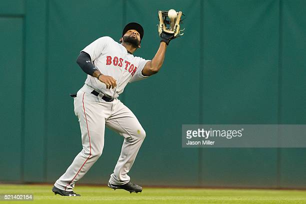 Center fielder Jackie Bradley Jr. #25 of the Boston Red Sox catches a fly ball hit by Juan Uribe of the Cleveland Indians to end the third inning at...