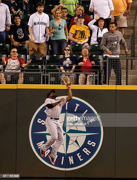 Center fielder Jackie Bradley Jr #25 of the Boston Red Sox makes a leaping catch on a ball off the bat of Logan Morrison of the Seattle Mariners in...