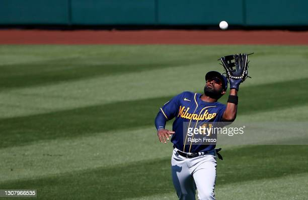 Center fielder Jackie Bradley Jr. #41 of the Milwaukee Brewers catches a fly ball out by Albert Pujols of the Los Angeles Angels during the fourth...