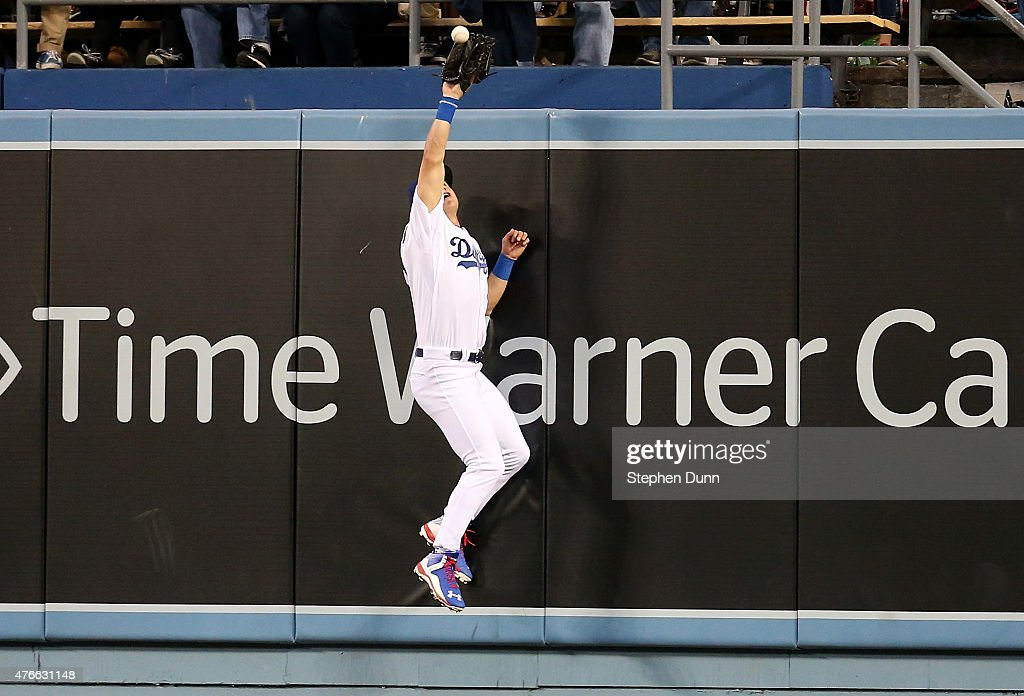 Center fielder Joc Pederson #31 of the Los Angeles Dodgers jumps at the wall to catch a drive off the bat of Yasmany Tomas of the Arizona Diamondbacks with two runners on base in the third inning at Dodger Stadium on June 10, 2015 in Los Angeles, California.